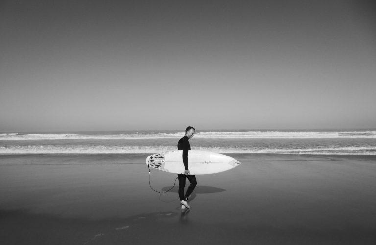 lone surfer surfboard